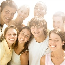 Group of teenagers smiling.
